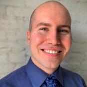 Ethan Rioux - Associate Director